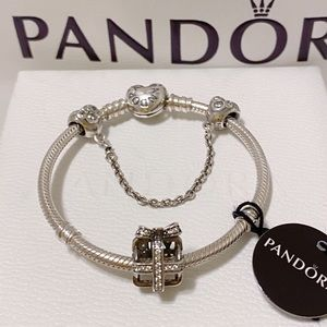 Pandora bracelet with charm and safetychain